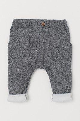 Мягкие теплые брюки с пушистыми отворотами